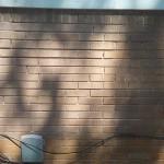 brick wall has its mortar restored